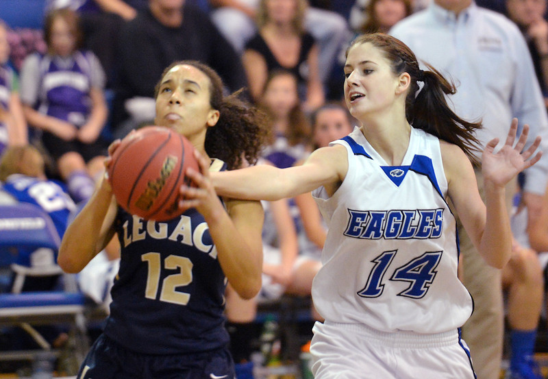 Broomfield's Meghan Stovall tries to knock the ball from Legacy's Mackenzie Neely during Saturday's girls basketball game at Broomfield.<br /> <br /> December 1, 2012<br /> staff photo/ David R. Jennings