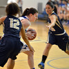 Broomfield's Bri Wilbur dribbles the ball between  Legacy's Mackenzie Gallegos and Emiley Lopez during Saturday's girls basketball game at Broomfield.<br /> <br /> December 1, 2012<br /> staff photo/ David R. Jennings