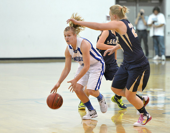 Broomfield's Callie Kaiser moves the ball down court against Legacy's Caitlyn Smith during Saturday's girls basketball game at Broomfield.<br /> <br /> December 1, 2012<br /> staff photo/ David R. Jennings