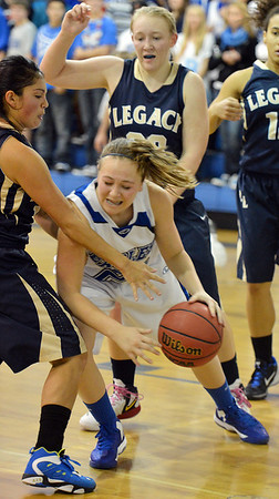 Broomfield's  dribbles around Legacy's Emiley Lopez during Saturday's girls basketball game at Broomfield.<br /> <br /> December 1, 2012<br /> staff photo/ David R. Jennings