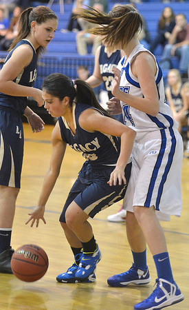Legacy's Emiley Lopez dribble the ball around Broomfield's Meghan Stovall during Saturday's girls basketball game at Broomfield.<br /> <br /> December 1, 2012<br /> staff photo/ David R. Jennings