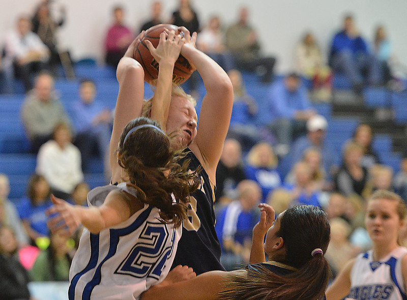 Legacy's Courtney Smith fights for the ball with Broomfield's Brenna Chase during Saturday's girls basketball game at Broomfield.<br /> <br /> December 1, 2012<br /> staff photo/ David R. Jennings