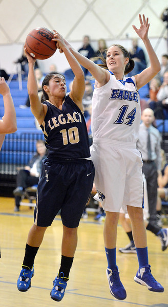Broomfield's  Meghan Stovall and  Legacy's Emiley Lopez fight for the ball during Saturday's girls basketball game at Broomfield.<br /> <br /> December 1, 2012<br /> staff photo/ David R. Jennings