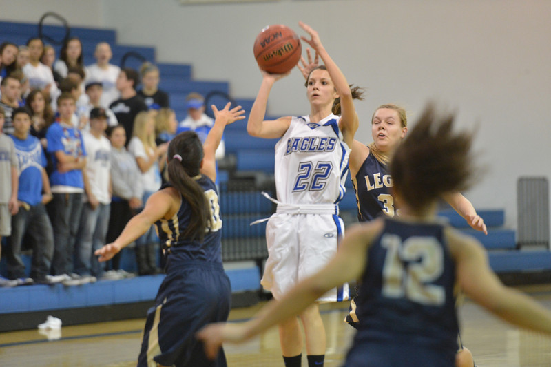 Broomfield's Brenna Chase shoots to the basket over Legacy's Emiley Lopez during Saturday's girls basketball game at Broomfield.<br /> <br /> December 1, 2012<br /> staff photo/ David R. Jennings