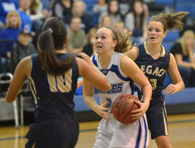Broomfield's Nicole Lehrer goes to the basket against Legacy's Emiley Lopez and Maddie Gallegos during Saturday's girls basketball game at Broomfield.<br /> <br /> December 1, 2012<br /> staff photo/ David R. Jennings