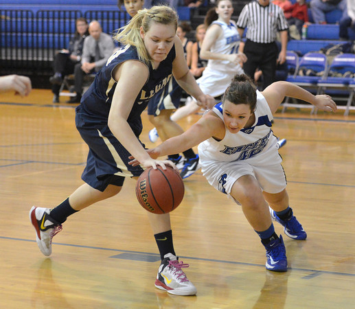 Legacy's Caitlyn Smith, left, and Broomfield's  Stacie Hull fight for control of the ball during Saturday's girls basketball game at Broomfield.<br /> <br /> December 1, 2012<br /> staff photo/ David R. Jennings