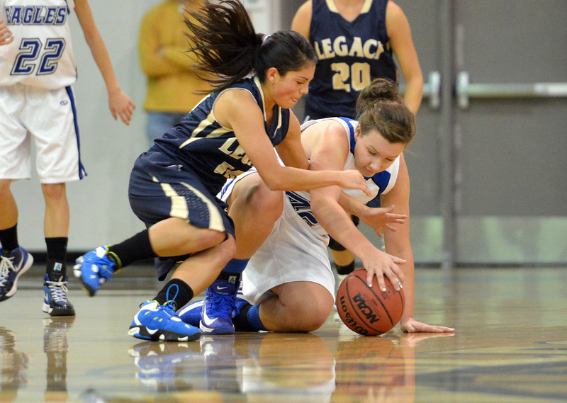 Broomfield's  Stacie Hull, right, and Legacy's Emiley Lopez scramble after a loose ball during Saturday's girls basketball game at Broomfield.<br /> <br /> December 1, 2012<br /> staff photo/ David R. Jennings