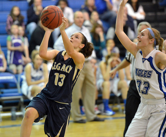 Legacy's Maddie Gallegos goes to the basket against Broomfield's Haylee Albrecht during Saturday's girls basketball game at Broomfield.<br /> <br /> December 1, 2012<br /> staff photo/ David R. Jennings