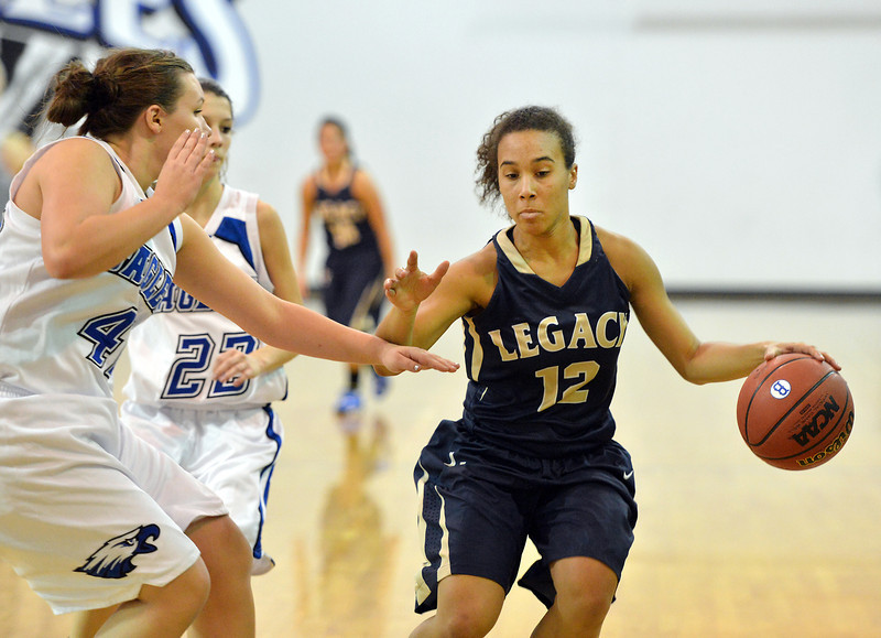 Legacy's  Mackenzie Neely dribbles aoround Broomfield's Stacie Hull and Brenna Chase during Saturday's girls basketball game at Broomfield.<br /> <br /> December 1, 2012<br /> staff photo/ David R. Jennings