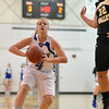 Broomfield's Callie Kaiser prepares to pass the ball against Thompson Valley's Cassie Baalke during Friday's game at Broomfield.<br /> January 18, 2013<br /> staff photo/ David R. Jennings