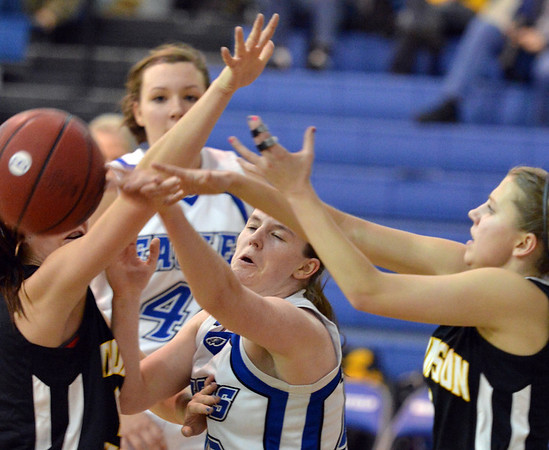 Broomfield's Bri Wilbur has the ball knocked out of her hands by Thompson Valley players during Friday's game at Broomfield.<br /> January 18, 2013<br /> staff photo/ David R. Jennings