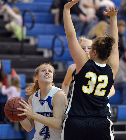Broomfield's Callie Kaiser eyes the basket past Thompson Valley's Cassie Baalke during Friday's game at Broomfield.<br /> January 18, 2013<br /> staff photo/ David R. Jennings