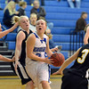 Broomfield's Nicole Lehrer goes to the basket between Thompson Valley players during Friday's game at Broomfield.<br /> January 18, 2013<br /> staff photo/ David R. Jennings