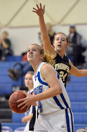 Broomfield's Callie Kaiser goes to the basket against Thompson Valley's Paige Chase during Friday's game at Broomfield.<br /> January 18, 2013<br /> staff photo/ David R. Jennings