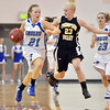 Broomfield's Nicole Lehrer dribbles the ball downcourt against Thompson Valley's Lexy Schoonovr during Friday's game at Broomfield.<br /> January 18, 2013<br /> staff photo/ David R. Jennings
