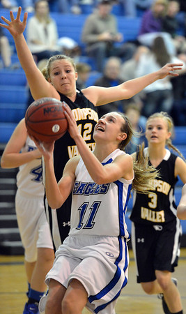 Broomfield's Katie Croell goes to the basket against Thompson Valley's Taylor Moran during Friday's game at Broomfield.<br /> January 18, 2013<br /> staff photo/ David R. Jennings