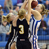 Broomfield's Nicole Lehrer goes to the basket against Thompson Valley's Lexy Schoonover and Josi Briggs during Friday's game at Broomfield.<br /> January 18, 2013<br /> staff photo/ David R. Jennings