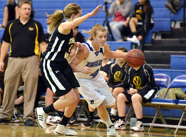 Broomfield's Callie Kaiser dribbles the ball to the basket against Thompson Valley's Paige Chase during Friday's game at Broomfield.<br /> January 18, 2013<br /> staff photo/ David R. Jennings
