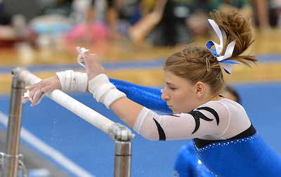 Broomfield's Melanie Stelling turns on the bar for her routine on the uneven parallel bars during the Broomfield Invitational Gymnastics Meet at Mountain Range High School on Saturday. September 29, 2012 staff photo/ David R. Jennings