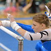 Broomfield's Melanie Stelling turns on the bar for her routine on the uneven parallel bars during the Broomfield Invitational Gymnastics Meet at Mountain Range High School on Saturday.<br /> September 29, 2012<br /> staff photo/ David R. Jennings