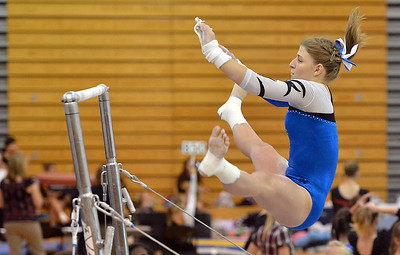 Broomfield's Melanie Stelling flies through the air to the second bar for her routine on the uneven parallel bars during the Broomfield Invitational Gymnastics Meet at Mountain Range High School on Saturday. September 29, 2012 September 29, 2012 staff photo/ David R. Jennings