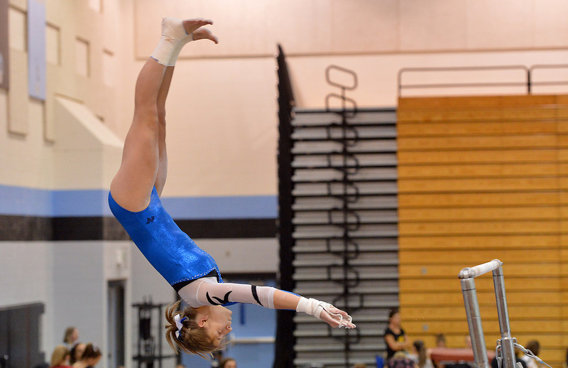 Broomfield's Melanie Stelling flies off the bar to finish her routine on the uneven parallel bars during the Broomfield Invitational Gymnastics Meet at Mountain Range High School on Saturday.<br /> September 29, 2012<br /> staff photo/ David R. Jennings