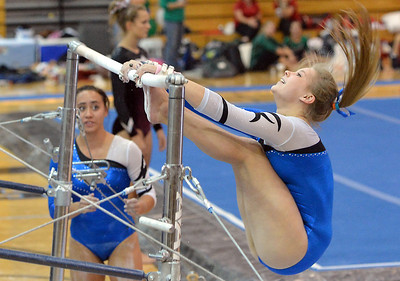 Broomfield's Kailey Licata performs her routine on the uneven parallel bars during the Broomfield Invitational Gymnastics Meet at Mountain Range High School on Saturday. September 29, 2012 staff photo/ David R. Jennings