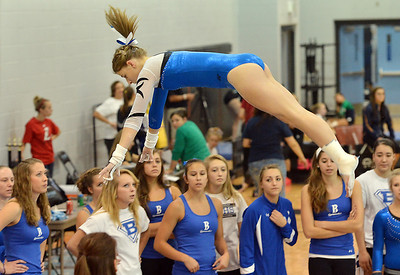 Broomfield's Melanie Stelling flies in the air to finish  her routine on the uneven parallel bars during the Broomfield Invitational Gymnastics Meet at Mountain Range High School on Saturday. September 29, 2012 staff photo/ David R. Jennings