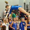Broomfield's Melanie Stelling flies in the air to finish  her routine on the uneven parallel bars during the Broomfield Invitational Gymnastics Meet at Mountain Range High School on Saturday.<br /> September 29, 2012<br /> staff photo/ David R. Jennings
