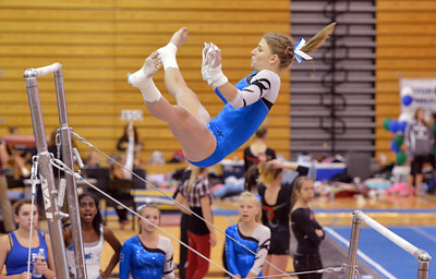 Broomfield's Melanie Stelling flies through the air to the second bar for her routine on the uneven parallel bars during the Broomfield Invitational Gymnastics Meet at Mountain Range High School on Saturday. September 29, 2012 staff photo/ David R. Jennings