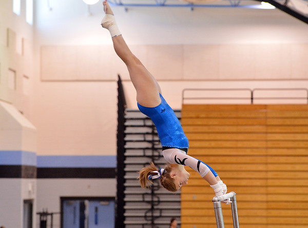 Broomfield's Melanie Stelling performs her routine on the uneven parallel bars during the Broomfield Invitational Gymnastics Meet at Mountain Range High School on Saturday.<br /> September 29, 2012<br /> staff photo/ David R. Jennings