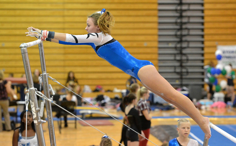 Broomfield's Jessica Riley performs her routine on the uneven parallel bars during the Broomfield Invitational Gymnastics Meet at Mountain Range High School on Saturday.<br /> September 29, 2012<br /> staff photo/ David R. Jennings