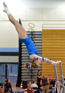 Broomfield's Melanie Stelling performs her routine on the uneven parallel bars during the Broomfield Invitational Gymnastics Meet at Mountain Range High School on Saturday. September 29, 2012 staff photo/ David R. Jennings