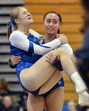 Broomfield's Melanie Stelling  is carried by teammate Gabby Maiden after getting injured during her floor routine at the Broomfield Invitational Gymnastics Meet at Mountain Range High School on Saturday.<br /> September 29, 2012<br /> staff photo/ David R. Jennings