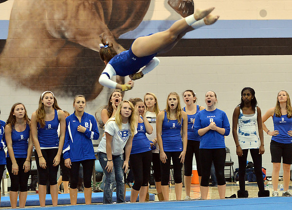Broomfield's Monique Martinez flies in the air as teammates cheer her on for her floor routine during the Broomfield Invitational Gymnastics Meet at Mountain Range High School on Saturday.<br /> September 29, 2012<br /> staff photo/ David R. Jennings