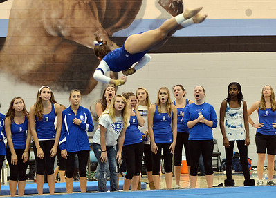 Broomfield's Monique Martinez flies in the air as teammates cheer her on for her floor routine during the Broomfield Invitational Gymnastics Meet at Mountain Range High School on Saturday. September 29, 2012 staff photo/ David R. Jennings