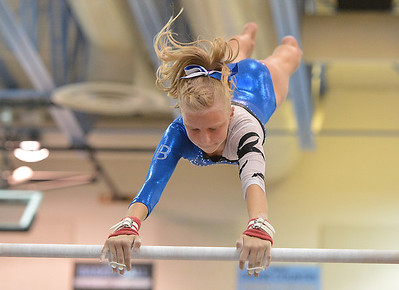 Broomfield's Heather Betz performs her routine on the uneven parallel bars during the Broomfield Invitational Gymnastics Meet at Mountain Range High School on Saturday. September 29, 2012 staff photo/ David R. Jennings