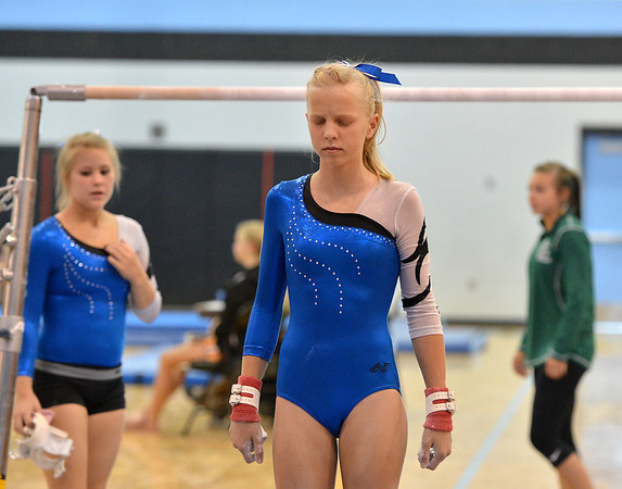 Broomfield's Heather Betz prepares to perform on the uneven parallel bars during the Broomfield Invitational Gymnastics Meet at Mountain Range High School on Saturday.<br /> September 29, 2012<br /> staff photo/ David R. Jennings