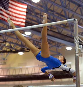 Broomfield's Maggie Boyer performs her routine on the uneven parallel bars during the Broomfield Invitational Gymnastics Meet at Mountain Range High School on Saturday. September 29, 2012 staff photo/ David R. Jennings