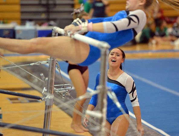 Broomfield's cheers on teammate Kailey Licata beginning her routine on the uneven parallel bars during the Broomfield Invitational Gymnastics Meet at Mountain Range High School on Saturday.<br /> September 29, 2012<br /> staff photo/ David R. Jennings