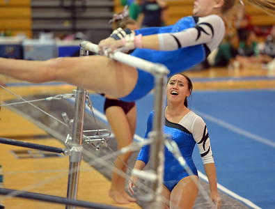 Broomfield's cheers on teammate Kailey Licata beginning her routine on the uneven parallel bars during the Broomfield Invitational Gymnastics Meet at Mountain Range High School on Saturday. September 29, 2012 staff photo/ David R. Jennings
