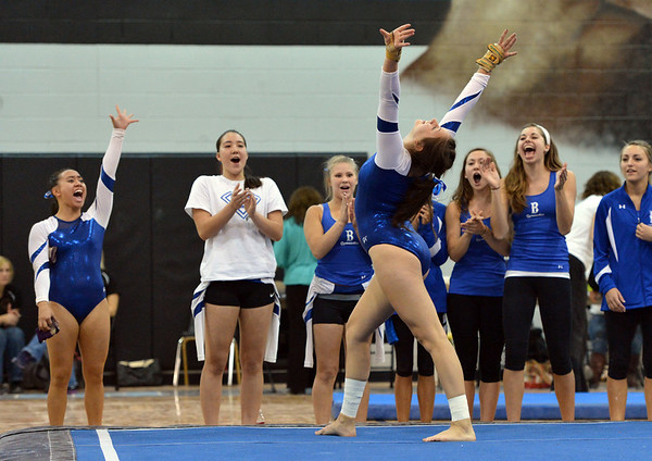 Broomfield's Monique Martinez performs her floor routine while being cheered on by teammates during the Broomfield Invitational Gymnastics Meet at Mountain Range High School on Saturday.<br /> September 29, 2012<br /> staff photo/ David R. Jennings