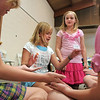 Kia Kidwell, 9, center left, plays a game with Jenna Vieux, 10, left, and Petra Jones, 9, while Joy Putnam, 10, watches during the girls self esteem workshop led by Gracie Forrey on Tuesday at Broomfield United Methodist Church.<br /> July 26, 2011<br /> staff photo/ David R. Jennings