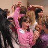 Petra Jones, 9, left, and Jenna Vieux, 10, work with their group to get untangled while holding hands during the girls self esteem workshop led by Gracie Forrey on Tuesday at Broomfield United Methodist Church.<br /> July 26, 2011<br /> staff photo/ David R. Jennings