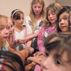 A group of girls hold hands before they try to untangle without breaking their hold during the girls self esteem workshop led by Gracie Forrey on Tuesday at Broomfield United Methodist Church.<br /> July 26, 2011<br /> staff photo/ David R. Jennings