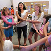 Gracie Forrey, 15, talks with her group while holding hands during Forrey's girls self esteem workshop on Tuesday at Broomfield United Methodist Church.<br /> July 26, 2011<br /> staff photo/ David R. Jennings