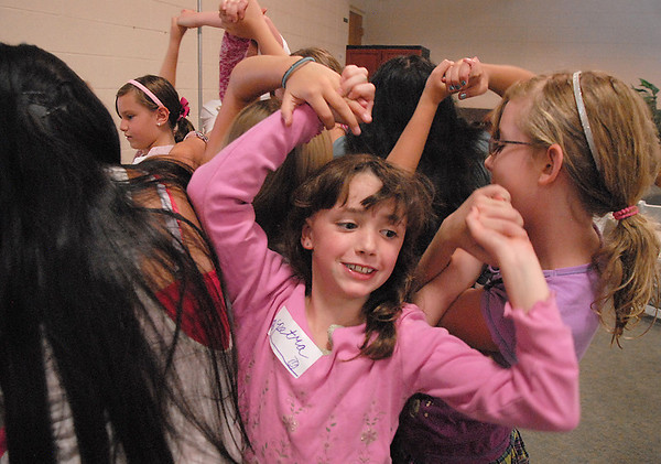 Petra Jones, 9, works with her group to get untangled while holding hands during the girls self esteem workshop led by Gracie Forrey on Tuesday at Broomfield United Methodist Church.<br /> July 26, 2011<br /> staff photo/ David R. Jennings