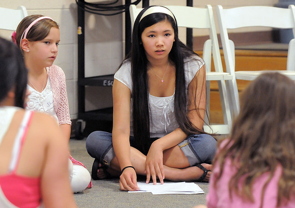 Gracie Forrey, 15, leads a group discussion about beauty adn the fashion industry during the girls self esteem workshop on Tuesday at Broomfield United Methodist Church.<br /> July 26, 2011<br /> staff photo/ David R. Jennings