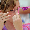 Jenna Vieux, 10, looks at herself in a mirror during the girls self esteem workshop led by Gracie Forrey on Tuesday at Broomfield United Methodist Church.<br /> July 26, 2011<br /> staff photo/ David R. Jennings