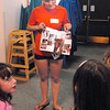 Laura McLean, 16, shows pictures in a magazine for girls in her group  during the girls self esteem workshop led by Gracie Forrey on Tuesday at Broomfield United Methodist Church.<br /> July 26, 2011<br /> staff photo/ David R. Jennings